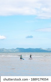 Kite boarding athletes dragged by the wind on shallow waters during the 2020 annual kite boarding competition in Sibaltan, El Nido, Palawan