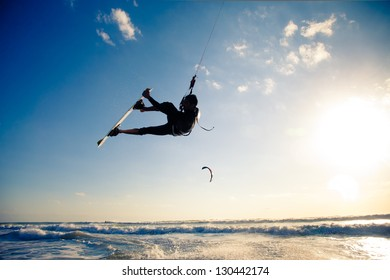 Kite boarding. Kitesurf freestyle at sunset.