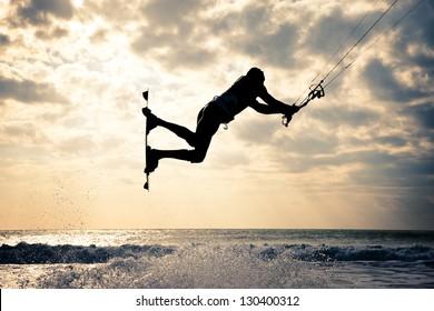 KITE BOARDING. Kite surfer jumping.