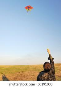 Kite. A colourful kite flying to the dark blue sky