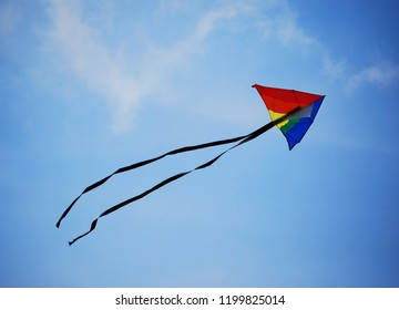 A kite flying in a blue sky