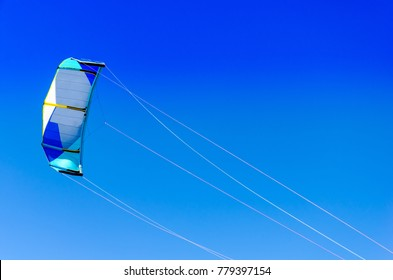 The kite kiteboarding closeup over with the bright blue sky as background