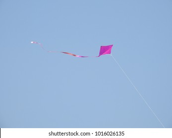 Kite with long tail flying in the sky high