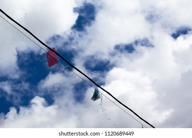 Kite on eletric line and blue sky