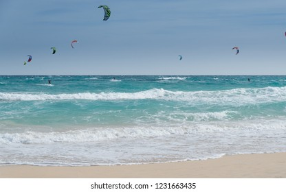 Kite surf in Lobos Island, Corralejo Natural Park in Canary Islands, Spain: wind, white sandy beach and turquoise water.