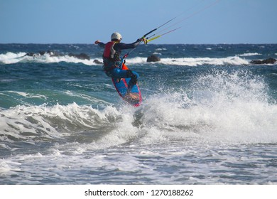 Kite surfer jumping in the waves of the Atlantic ocean