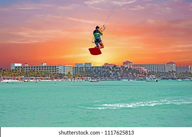 Kite surfer at Palm Beach on Aruba island at sunset