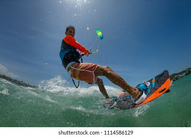 Kite surfer rides the waves