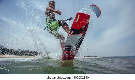 Kite Surfer Riding Wave