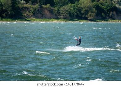 Kite surfers race across the sea