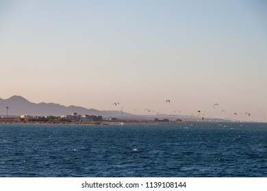 Kite Surfers Riding on the Red Sea at Sunset in El Gouna, Egypt