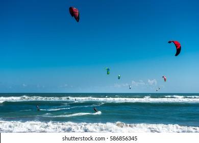 Kite surfers in the wavy waters of Canggu Bali, Indonesia.