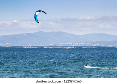 Kite surfing in Arousa estuary with mussel aquaculure rafts at background