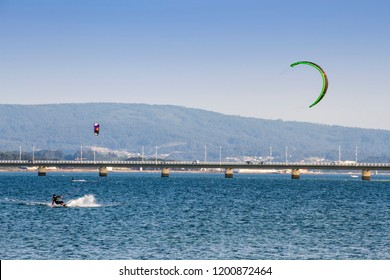 Kite surfing next to Arousa Island bridge, Galicia, Spain