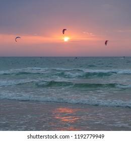 Kite surfing at sunset. Mediterranean sea evening view. Herzliya, Israel sand beach