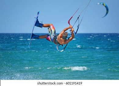 kiteboarder kitesurfer athlete performing kitesurfing kiteboarding tricks unhoocked