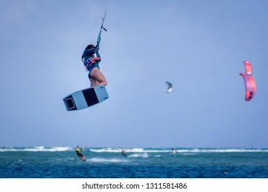 kiteboarder kitesurfer woman jump athlete performing kitesurfing kiteboarding jumping