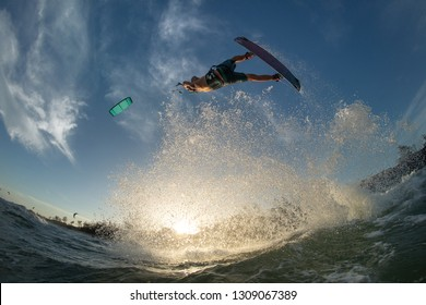 Kiteboarding action photos man among waves quickly goes