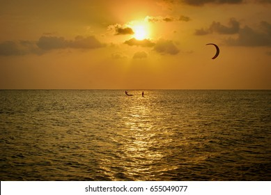 kiteboarding schoop - teaching kitesurfing student at sunset - surf surfing spot school
