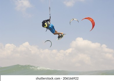 Kiteboarding in a summer day on  a Mediterranean sea coast