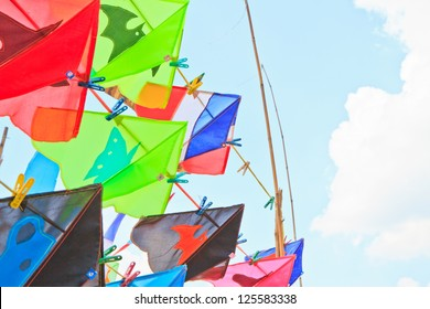 The kites against the blue sky background