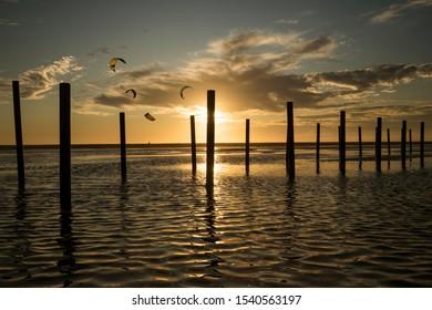 Kites at sunset in Los Lances beach,  Tarifa, Cadiz, Andalusia, Spain