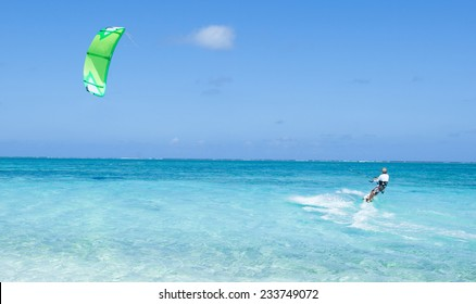 Kitesurfer in action on clear blue tropical water, Kume Island, Okinawa, Japan