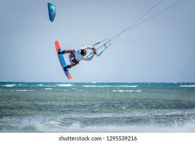 kitesurfer athlete performing kitesurfing