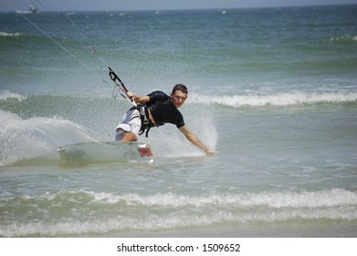 A kitesurfer concentrates intensely as he approaches the beach at Ponce Inlet Beach, Florida