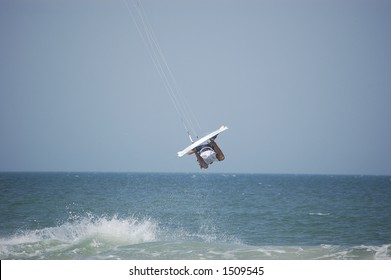 A kitesurfer gets fully airborne at Ponce Inlet Beach, Florida