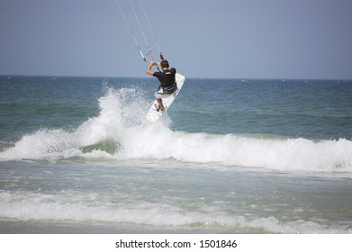 A kitesurfer launches into the air off a breaker on Ponce Inlet Beach, Florida