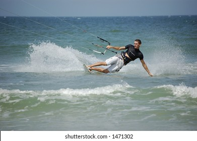 A kitesurfer leans hard as he turns the corner at Ponce Inlet beach, Florida
