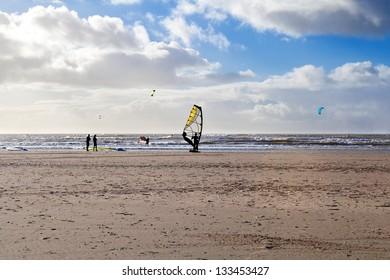 kitesurfer on sand beach at North sea, Netherlands