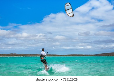 Kitesurfer playing in the turquoise lagoon of Diego Suarez, Madagascar.