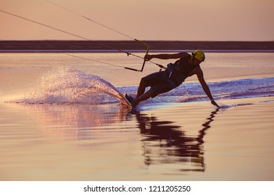 Kitesurfer touches water in contre