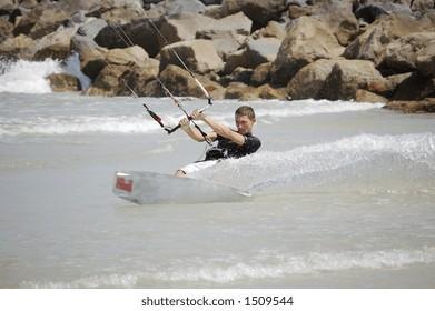 A kitesurfer turns sharply at Ponce Inlet Beach, Florida