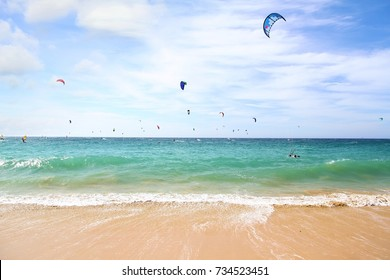 Kitesurfers sailing in Playa Los Lances of Tarifa in Spain.