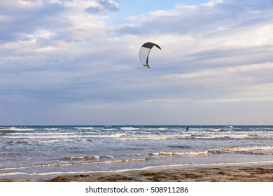 Kitesurfing in a cloudy autumn day. Lady's Mile beach in Limassol, Cyprus