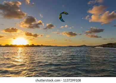 Kitesurfing during sunset at Elafonissi beach, with Balos beach both in Crete Island, maybe the nicest beaches in the world