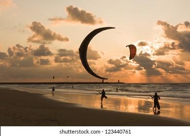 Kitesurfing in the evening at a Dutch beach