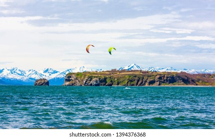 Kitesurfing, kiteboarding, kite surf. Extreme sport kitesurfing in Kamchatka Peninsula in the Pacific ocean
