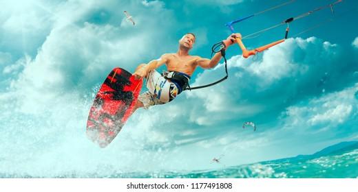 Kitesurfing. Man rides on kite on waves
