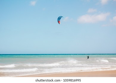 Kitesurfing in the ocean on Canary Islands beach, Fuerteventura, Spain