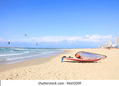 Kite-surfing on Mediterranean coast and view of Tel-Aviv beach. Israel