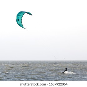 Kitesurfing on the waves of a dutch lake