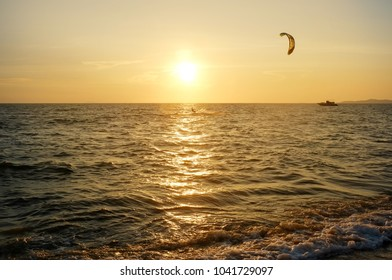 Kite-surfing with sunset at Jomtien beach, pattaya, Chonburi, Thailand