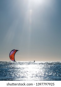 kitesurfing (the sail pulls along the waves of a man on the board)