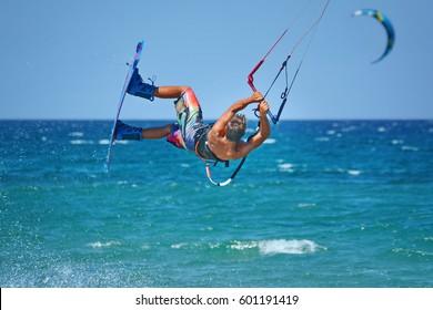 kitheboarder kitesurfer athlete performing kitesurfing kiteboarding tricks unhoocked