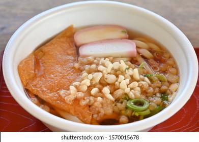 Kitsune Udon with tofu and fish cake, Japanese food