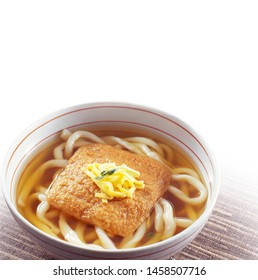 Kitsune-Udon (Udon wheat noodles served in a hot broth, topped with sweetened fried tofu)